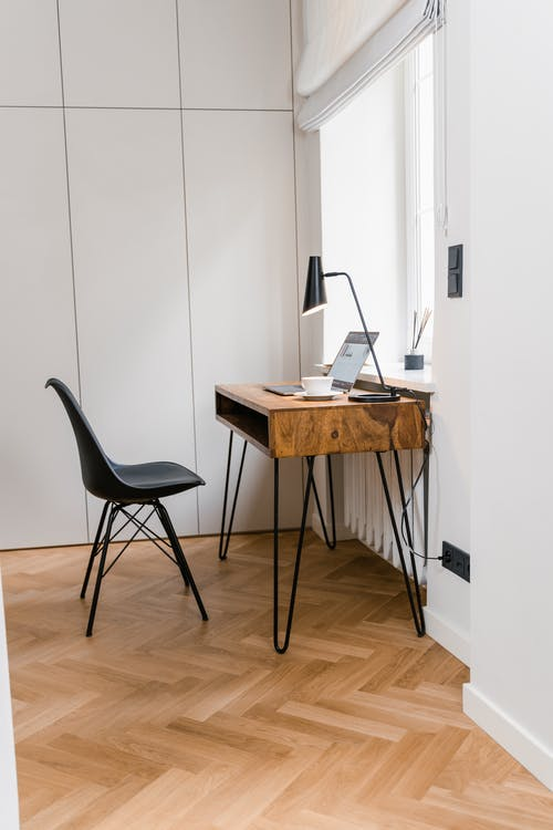 rown Wooden Desk and Black Chair