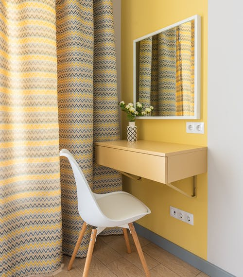 nterior of room corner with table and mirror for woman