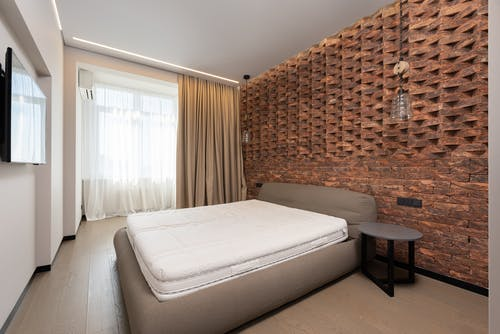 pacious bedroom with decorated wall